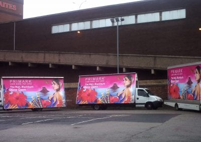 Three Advertising Vans Primark Blackburn Lancashire promoting store opening