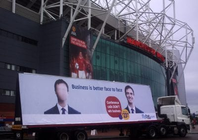 Flybe Face to Face 96-sheet AdTrailer promoting business air travel outside Old Trafford Manchester