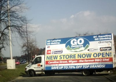 Advertising Van near busy main road advertising Go Outdoors new store opening near Wigan