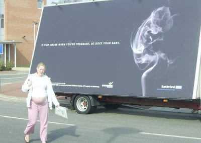 Mobile Billboard Advertising NHS Dont Smoke When Pregnant with expectant mother walking in front